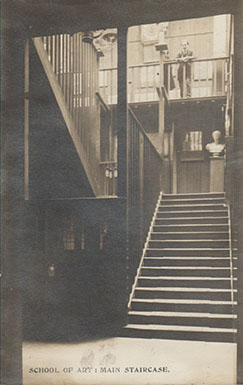 GSA Archives photographic postcard of the main staircase of the Mackintosh Building (Archives reference: GSAA/P/7/368)