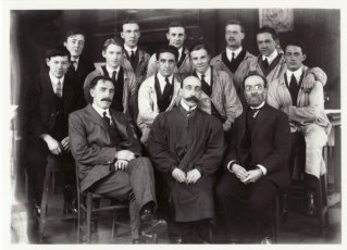 GSA architecture group photograph featuring Charles Gourlay, Eugene Bourdon, Alexander McGibbon (front L-R), and students including Smith and Albert Cordiner. Glasgow School of Art Archives and Collections (archive reference: GSAA/P/1)