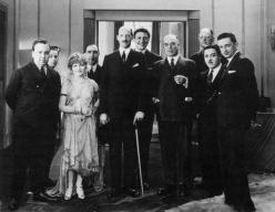 British International Pictures group photograph taken in the late 1920s (L-R Alfred Hitchcock, J. Grossman, Betty Balfour, Walter Mycroft, P. Hage, Carl Brisson, John Maxwell, unknown, Monty Banks, E.A. Dupont). Image Courtesy of The Alfred Hitchcock Wiki.
