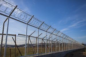 Adding barbed wire to your high security fence gives it an extra layer protection and makes it harder to climb over.