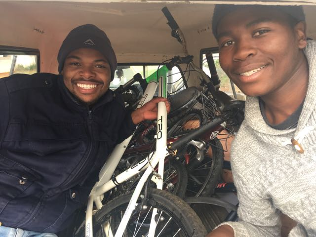 Owner-manager of KCD Cycling Luxolo Kopeshe (left) and owner-driver Bongani Stamp (right) transporting bicycles in preparation for the tour on 21 July 2017