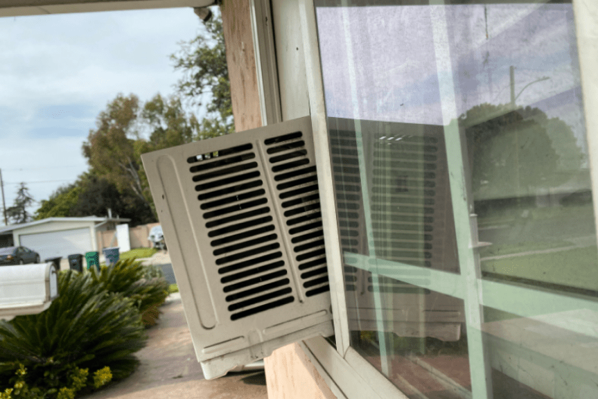 air conditioner sticking out of window