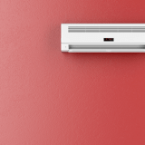 ductless air conditioning unit on red wall