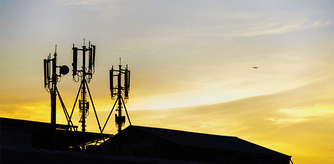 Silhouette cellular antennas at sunrise