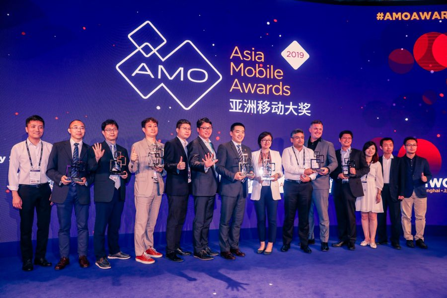 14 people on stage celebrating after winning separate Asia Mobile Awards in 2019