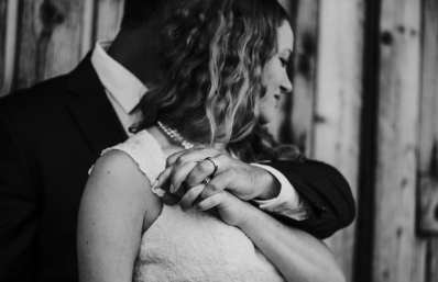 Intimate Bride and Groom Portrait on the Wedding Day embracing showing off the wedding rings