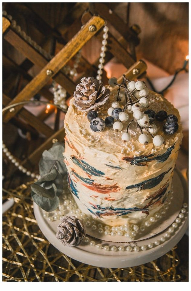 Winter Wedding at the Lookout Lodge in Snohomish wedding cake, birch cake, pearls, pinecones, eucalyptus, berries, gold, wood, white, frost
