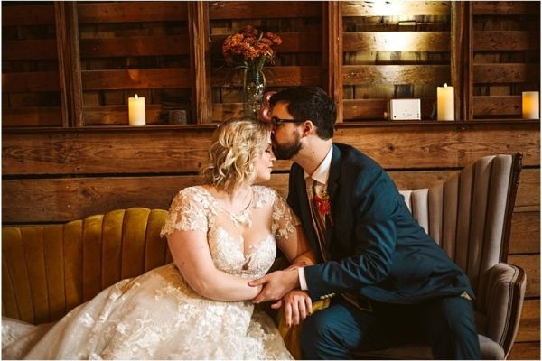 barn at holly farm classic couple on a vintage couch groom kissing brides forehead snohomish wedding photographer seattle