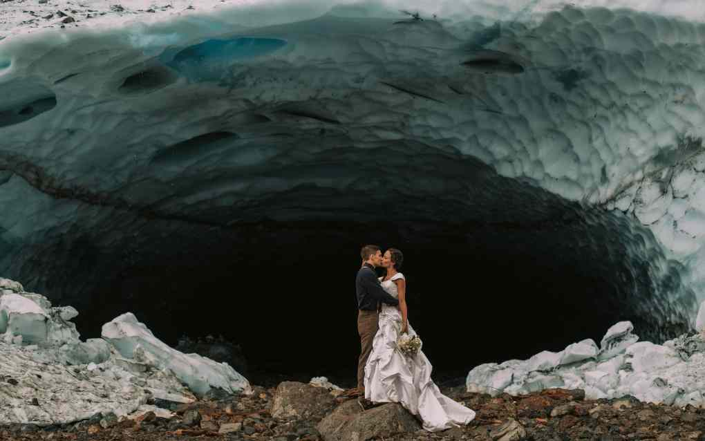 Elopement at Big Four Ice Caves in Granite Falls Washington with blue and white ice and a white wedding gown