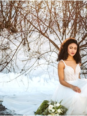leavenworth winter wedding styled shoot at silvara winery black bride in a blue wedding gown from french knot couture