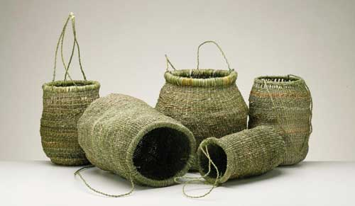 Contemporary Tasmanian Aboriginal baskets. Left to right: Vicki maikutena Green, Patsy Cameron (also second from right), Dulcie Greeno, Audrey Frost. Image courtesy of the Tasmanian Museum and Art Gallery