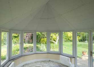 Clad over conservatory roof from inside