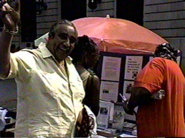 Harlem's Congressman Charles Rangel shows his support of NYS Courts Guardian's work in the community at our Harlem Day Booth.