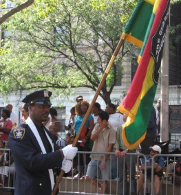 NYS Court Officer Tyrone Sanders carrying our Guardian Flag.