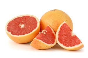 Citrus_paradisi_(Grapefruit,_pink)_white_bg