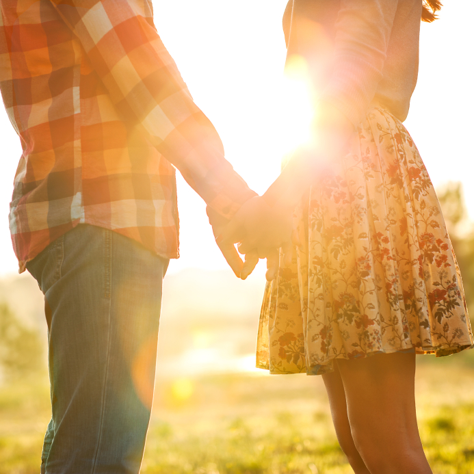 image of young couple holding hands