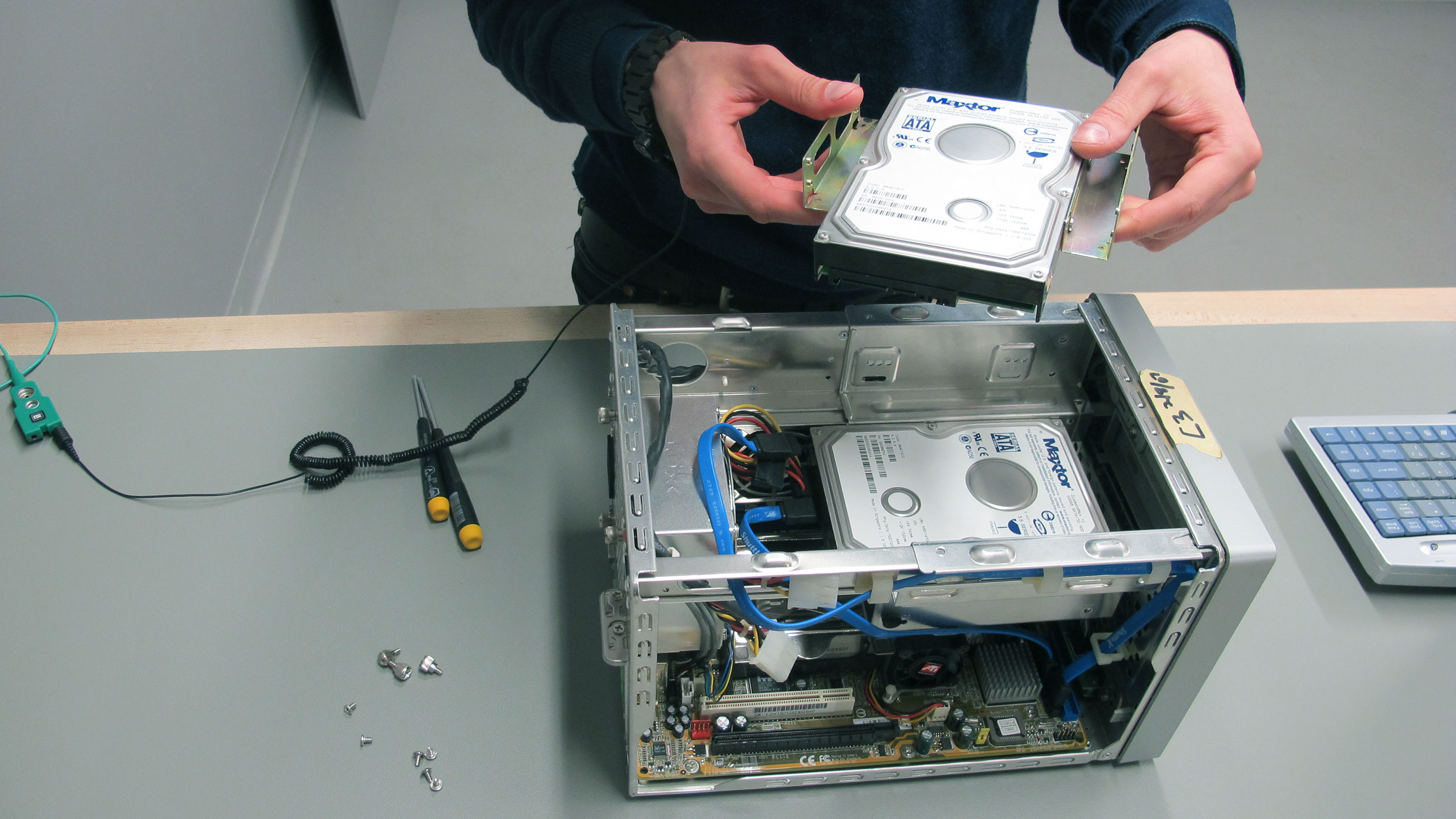 In order to create a write-blocked disk image of this vintage shuttle computer, the hard drive is removed in the Guggenheim's time-based media conservation lab. Photo: Joanna Phillips