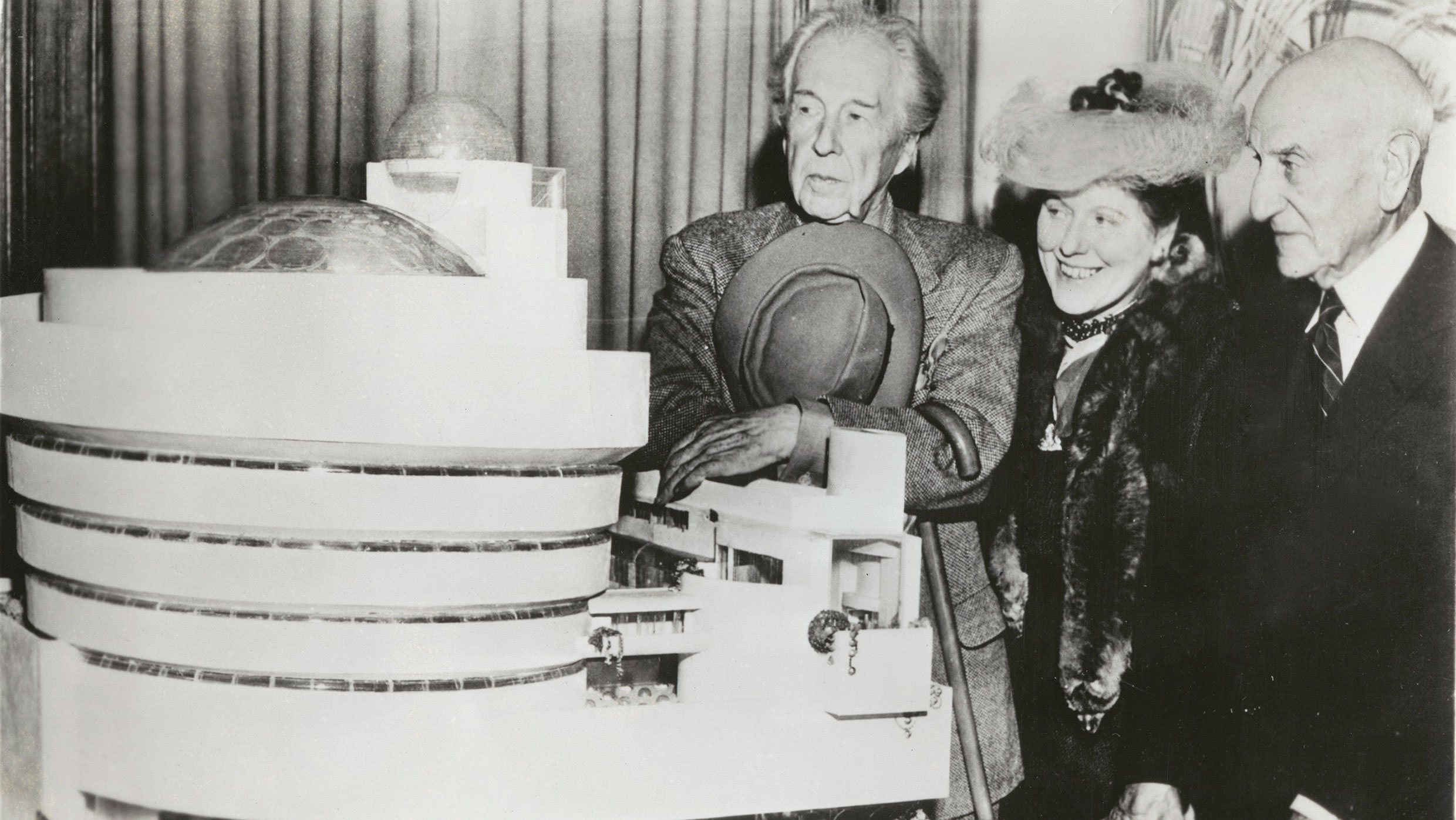 Frank Lloyd Wright, Hilla Rebay, and Solomon Guggenheim with a model of Wright's design for the new museum, Plaza Hotel, New York, 1945. Photo: Margaret Carlson, courtesy Library of Congress, Washington, D.C.
