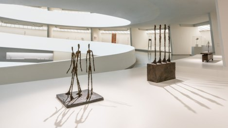 Sculpture of three tall thin people in the Solomon R. Guggenheim Museum