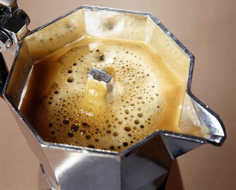an Italian coffee pot full of coffee, shown from above