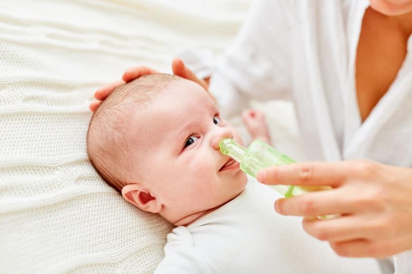 baby with nasal aspirator