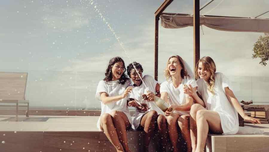 women celebrating with bottles