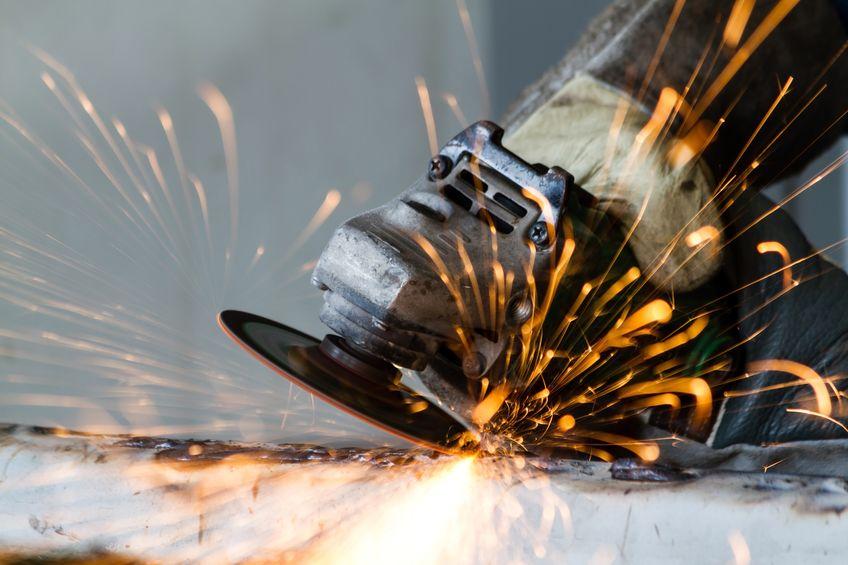 metal grinding on steel pipe close up