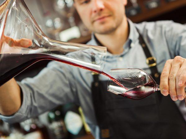bartender with a wine jar