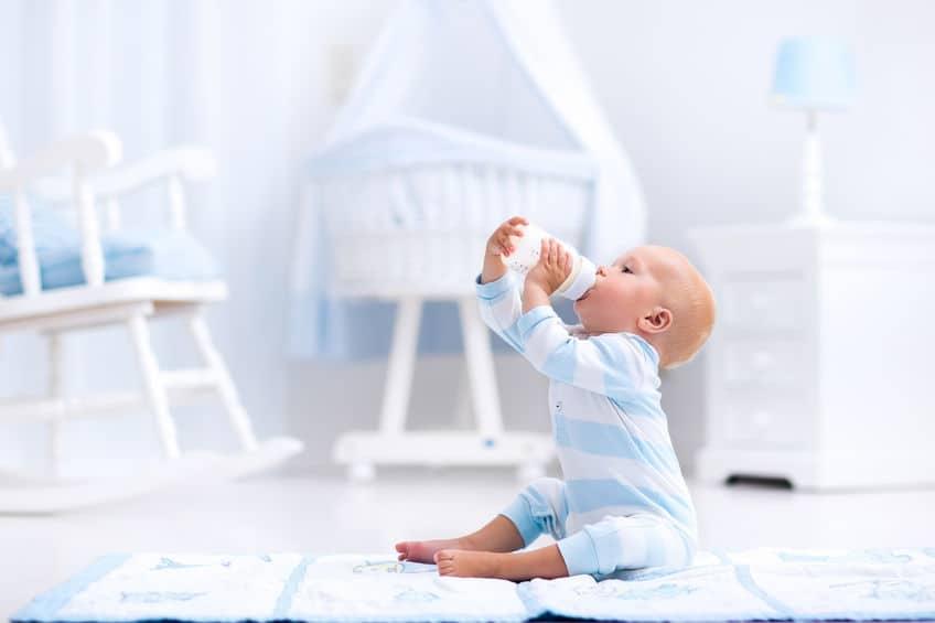 little baby drinking some milk