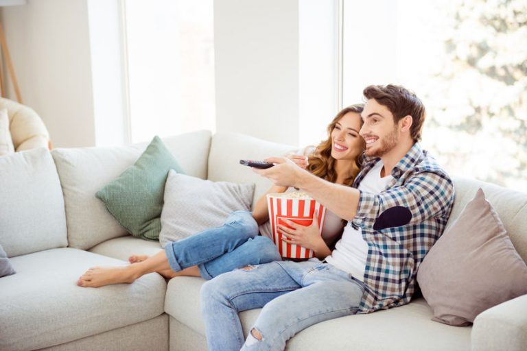 couple on a sofa watching tv