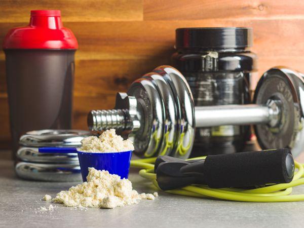 Whey protein powder in scoop.