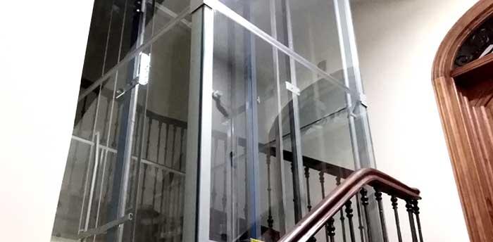 Cortina vidrio ascensor