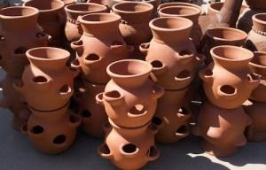 contenitori a orcio in terracotta per la coltivazione delle fragole in vaso o contenitore