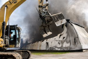 Caterpillar Attacking a Burning Building