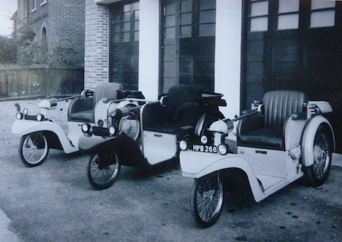 Examples of Nelco's electric Solotron cars, pictured outside the factory in Station Road, Shalford.