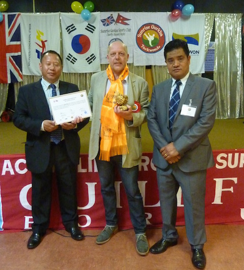 From left: the chairman of the Sunrise Gurkha Sports Club, Budhi Gurung; David Rose and the club's managing director Navaraj Ghale.