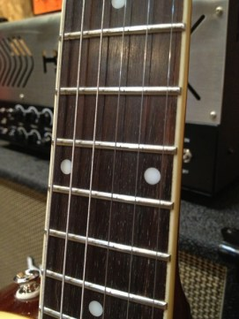 Rosewood, not toasted bread!!! and dot inlays