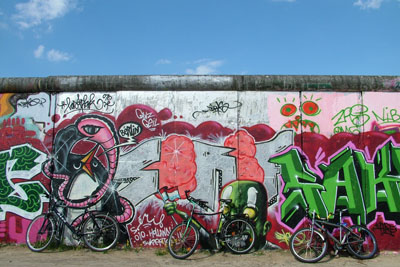 Bikes leaned up against a memorial stretch of the Berlin Wall
