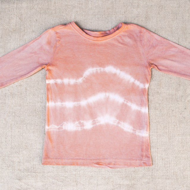 Shibori resist lines on avocado dyed cotton