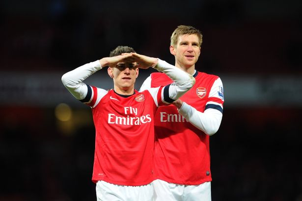 Laurent Koscielny and Per Mertesacker