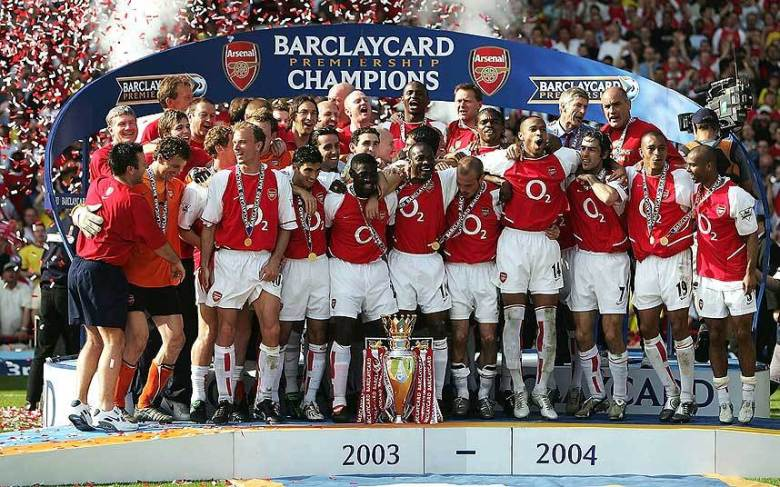 Arsenal celebrate winning the league at White Hart Lane