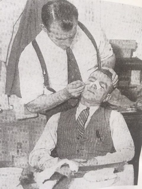 Eddie Hapgood getting treated for his broken nose by Tom Whittaker