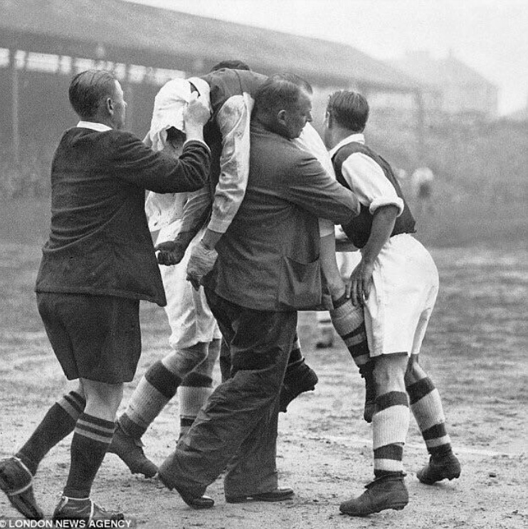 Ted Drake is carried off at Brentford by Tom Whittaker unconscious