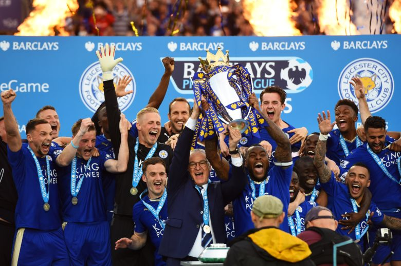 LEICESTER, ENGLAND - MAY 07: Captain Wes Morgan and manager Claudio Ranieri of Leicester City lift the Premier League Trophy after the Barclays Premier League match between Leicester City and Everton at The King Power Stadium on May 7, 2016 in Leicester, United Kingdom. (Photo by Laurence Griffiths/Getty Images)