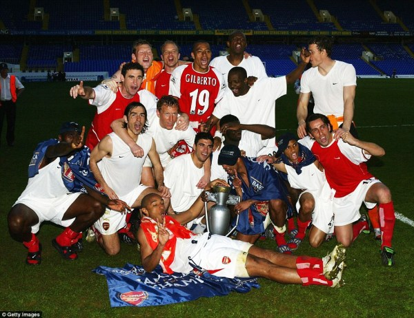 Robert celebrates with the rest of the Arsenal players