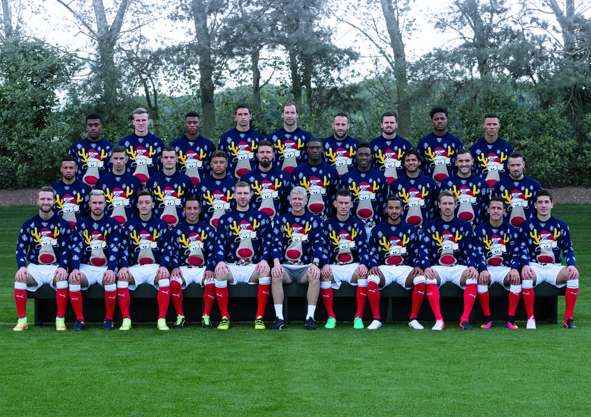 Arsenal's first team supports Save the Children's Christmas Jumper Day.