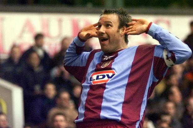 Merse celebrates a goal for Aston Villa