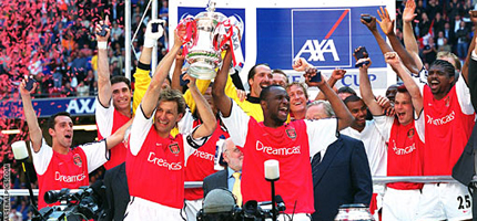 Tony Adams and Patrick Vieira lift the FA Cup together in 2002
