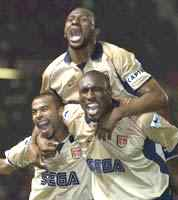 Paddy celebrates winning the Title and clinching the Double with Ashley Cole and Sol Campbell