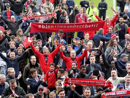 Leyton Orient fans. They look happy.